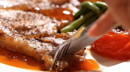 Pork chop steak serve with vegetable in restaurant Стоковые видеозаписи