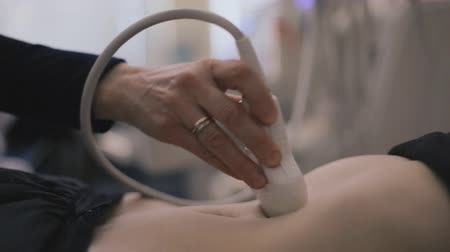 gyomor : Medical doctor making ultrasound with modern equipment