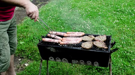 grilling : Summer time grill on the grass. A well known process done fine Stock Footage