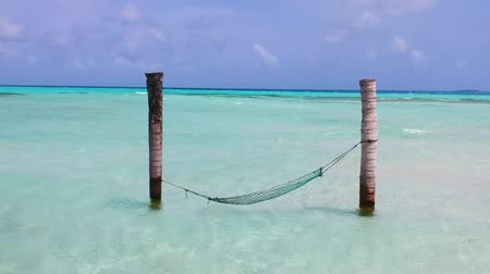 Hammock in the middle of turquoise water