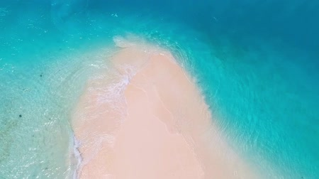 Sand tongue from above surrounded by turquoise water