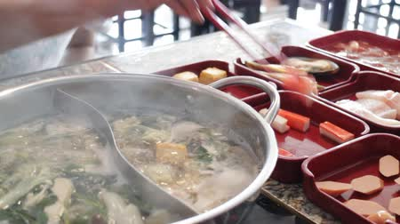 hotpot : Filling variety meat to hot pot shabu, stock video