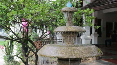 front or back yard : Three tiered garden fountain flowing with water Stock Footage