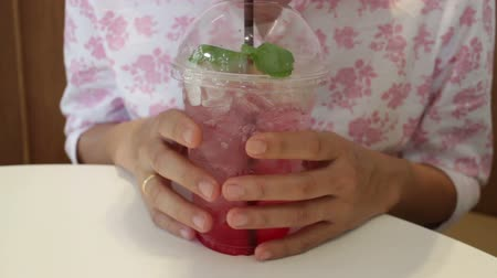 tasting : Woman tasting iced mix berry soda, stock footage