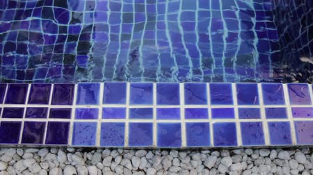 Blue clay square tiles border of simple swimming pool, stock footage Stock Footage