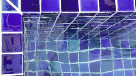Blue clay square tiles corner of swimming pool, stock footage Stock Footage