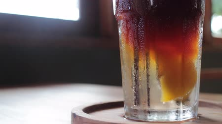 savanyú : Iced glass of peach soda drink up close, stock footage Stock mozgókép