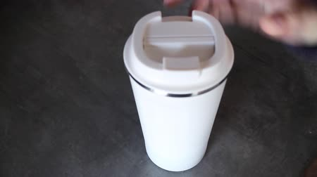 Hand opened no straw reusable thermo cup, stock footage