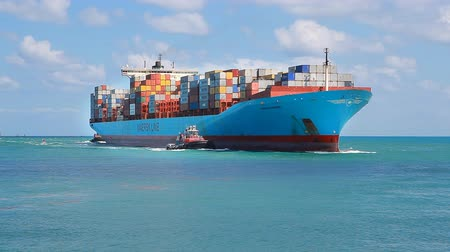 navigasyon : Miami, Fl, USA - APRIL 13, 2017: Large cargo ship Adrian Maersk from Maersk Line with many shipping containers sailing to port Miami Stok Video
