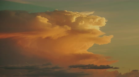 low lighting : Storm Cloud Sunset - Sunset on desert cumulonimbus clouds.