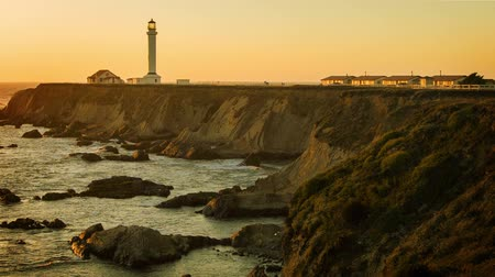 low lighting : Gold Coast Lighthouse - A static sunset shot of northern California light house. Stock Footage