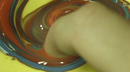 dedo : Finger Paint - A slow motion high detail shot of person finger painting.