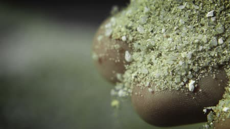 talaj : Sand Through Fingers - A macro high speed shot capturing sand falling through fingers. Stock mozgókép