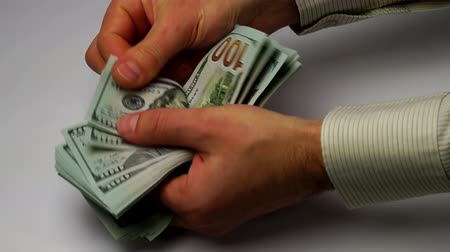 para kazanmak : hands calculate new banknotes of dollars