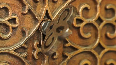 coffer : Bronze Casket with the Key in the Keyhole Rotated . Macro Shooting.