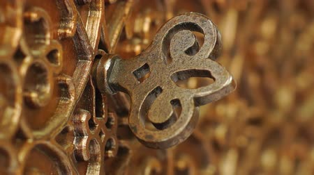 coffer : Bronze Casket with the Key in the Keyhole Rotated. Macro Shooting.