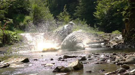 Enduro Motocycle Rider Crosses Mountain River Splashes of Water and Dirt. Slow Motion. Stok Video