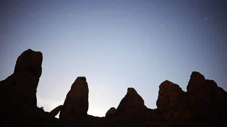 trona : Motion controlled dolly time lapse footage of moon rising over monolithic formation in the desert of Trona