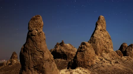 trona : Astrophotography time lapse of close up shot of night to day transition over eroded formation in Trona Pinnacles Stock Footage