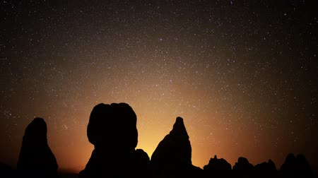 trona : Astrophotography time lapse footage with tilt down motion of starry sky over monolithic formations in Trona Pinnacles