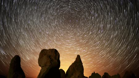 trona : Astrophotography time lapse footage of star trails over monolithic formations in Trona Pinnacles