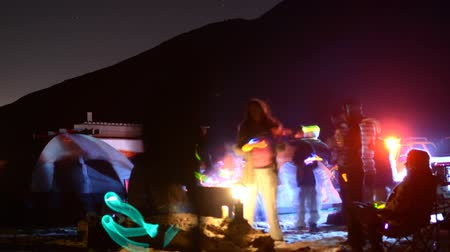 приморский : Time lapse footage with zoom out motion of campers enjoying company at night on the Beach in Malibu
