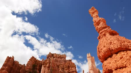 movements : Time lapse footage with tilt down motion of cloudscape over hoodoos in Bryce Canyon National Park Stock Footage