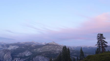 glacier point : Time lapse footage with tilt up motion of sunset afterglow over High Sierra mountain range in Yosemite National Park