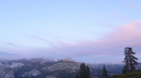 glacier point : Time lapse footage with tilt down motion of sunset afterglow over High Sierra mountain range in Yosemite National Park