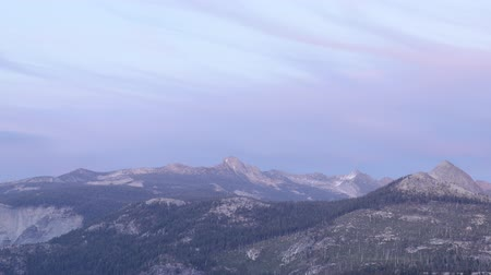 glacier point : Time lapse footage of sunset afterglow over High Sierra mountain range in Yosemite National Park Stock Footage