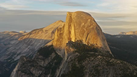 glacier point : Time lapse footage with pan right motion of half dome at sunset afterglow in Yosemite National Park