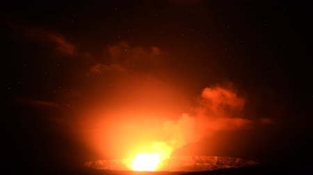 barışçı : Astrophotography time lapse footage with tilt down motion of stars over active Halemaumau Crater of Kilauea Volcano in Hawaii Volcanoes National Park