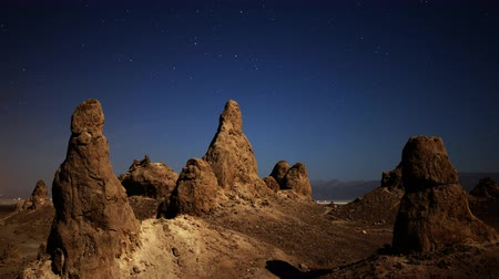 trona : 4K astrophotography time lapse of night to day transition over eroded formation in Trona Pinnacles