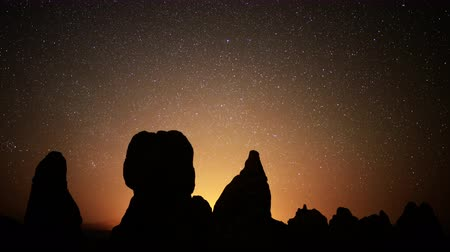 trona : 4K Astrophotography time lapse footage with tilt up motion of starry sky over monolithic formations in Trona Pinnacles