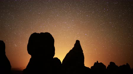 trona : 4K Astrophotography time lapse footage with zoom out motion of starry sky over monolithic formations in Trona Pinnacles