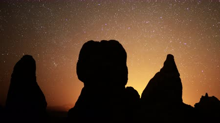 trona : 4K Astrophotography time lapse footage of starry sky over monolithic formations in Trona Pinnacles Stock Footage