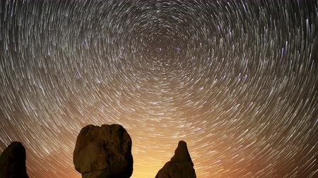 trona : 4K Astrophotography time lapse footage with zoom in motion of star trails over monolithic formations in Trona Pinnacles