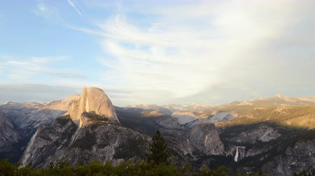 glacier point : 4K Time lapse footage with pan right motion of half dome at sunset afterglow in Yosemite National Park