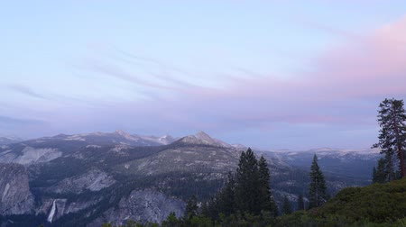 nevada : 4K Time lapse footage with pan right motion of sunset afterglow over High Sierra mountain range in Yosemite National Park