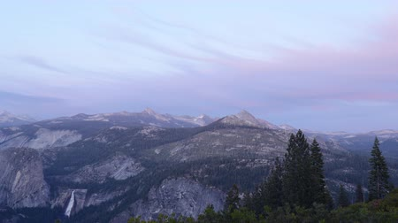 glacier point : 4K Time lapse footage with zoom out motion of sunset afterglow over High Sierra mountain range in Yosemite National Park