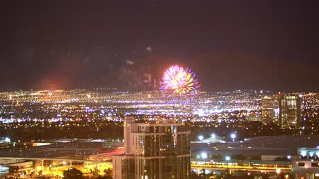 tiras : Time Lapse of Fireworks over Cityscape in Las Vegas -Zoom In- Stock Footage