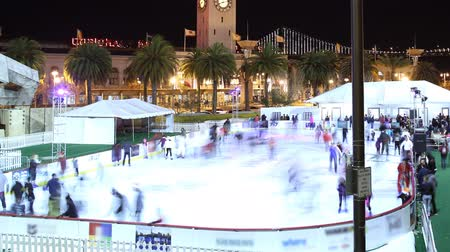 skate : Time Lapse of Ice Skate Rink at San Francisco Waterfront on Holidays Zoom Out
