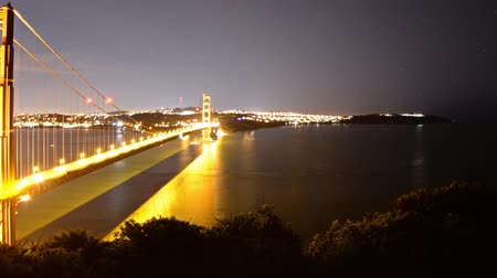 zametání : Motion Control DollyPan Time Lapse of Golden Gate Bridge Night to Day Zoom Out