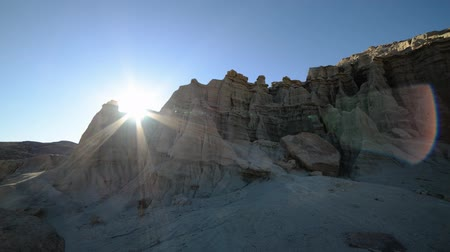 movements : Time Lapse of Sun Shining through Sandstone Formation Tilt Up