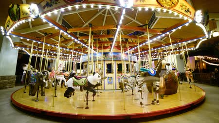 turysta : Time Lapse of Merry Go Round at Night Tilt Up Wideo