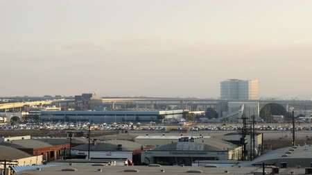 sinema : 4K Time Lapse of Airport Cloudscape at LAX Pan Left Stok Video