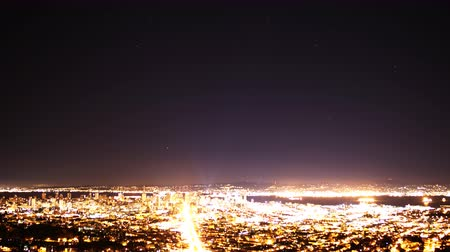 sinema : 4K Time Lapse of Star Trails over Bay Area Cityscape Night to Day Zoom Out