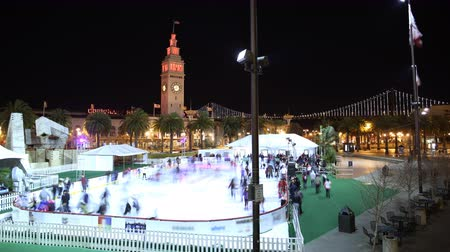 skate : 4K Time Lapse of Ice Skate Rink at San Francisco Waterfront on Holidays Tilt Up
