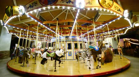 plac zabaw : 4K Time Lapse of Merry Go Round at Night Tilt Down Wideo