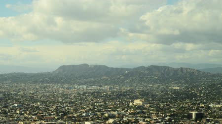 esquerda : Time lapse with pan left motion of cityscape in Los Angeles during daytime shot from building top Stock Footage